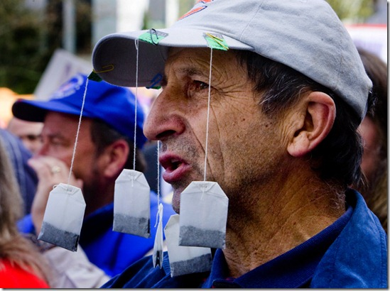 Thousands turn out at the State Capitol to rally against Obama policies, huge deficits, bigger government and higher taxes.  Corneliu Constantinescu (CQ) wears tea bags on his hat at the rally on the steps of the Capitol.</p><p> Photo by Doug Beghtel/ The Oregonian